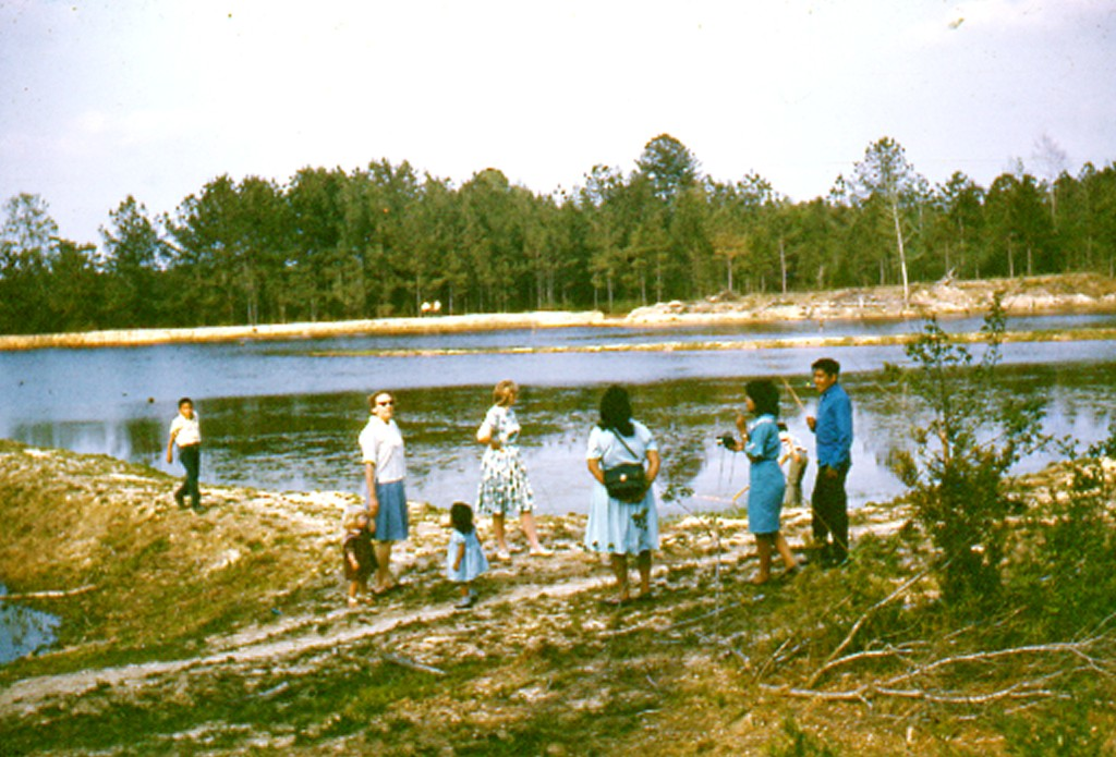 Bender Family observe Pine Lake in the early days.