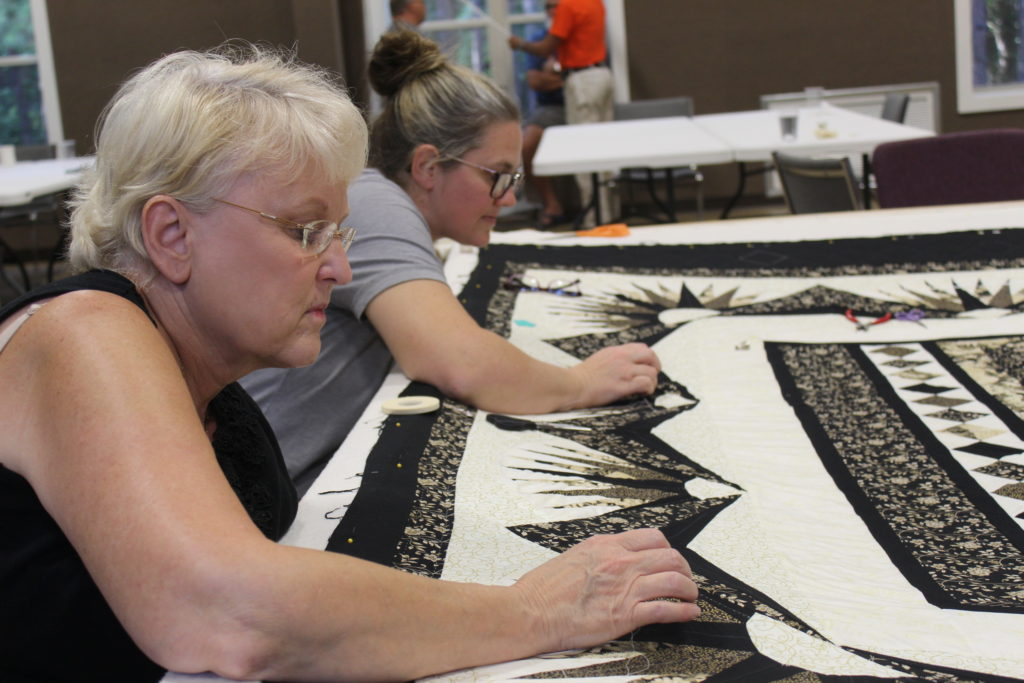 Ladies quilting on the 2020 Camp Quilt