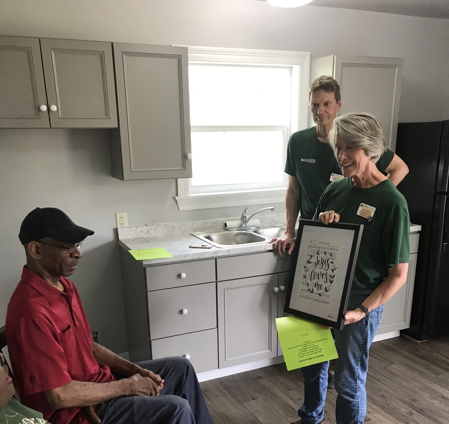 Mr Willie presented with a wall hanging for his kitchen